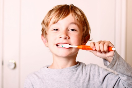 Boy brushing teeth at Michael B. Litchfield, DMD, Family Dentistry